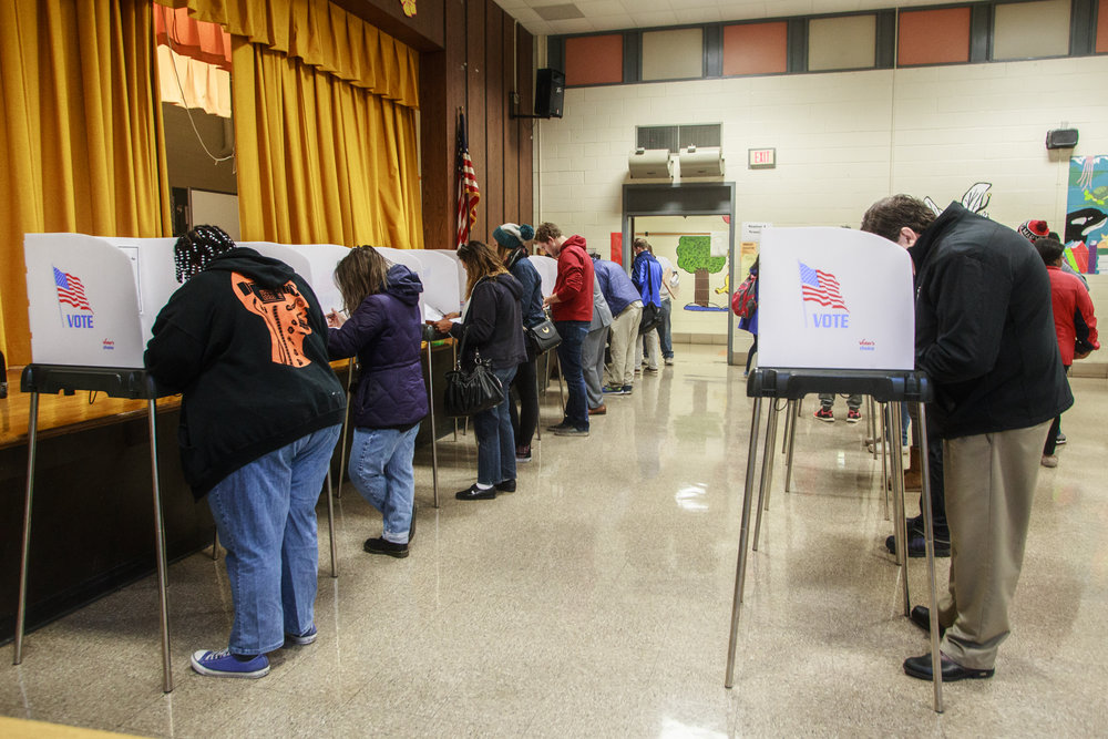 Voters fill out their ballots in the Paint Branch Elementary school voting location on Tuesday, Nov. 8, 2016. While Maryland voted heavily democratic, it was not enough to help nominee Hillary Clinton clinch the necessary 270 Electoral votes.