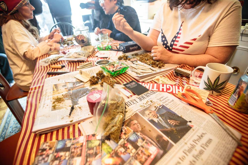 DCMJ volunteer Elizabeth Croydon, 46, rolls a joint at a table in the organization's headquarters building on Thursday, Jan. 19, 2017. The D.C.-based marijuana legalization group is planning to protest President-elect Donald Trump's stated opposition to federal legalization of marijuana by passing out over 4,200 joints at Friday's inauguration.    (Tom Hausman/Capital News Service via AP)