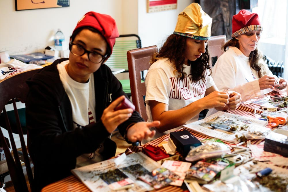 DCMJ volunteers Natalie de Leon, 26 (left), Amanda Krause, 26 (center), and RachelRamone Donlan, 45 (right), roll joints at the organization's headquarters building on Thursday, Jan. 19, 2017. The D.C.-based marijuana legalization group is planning to protest President-elect Donald Trump's stated opposition to federal legalization of marijuana by passing out over 4,200 joints at Friday's inauguration.    (Tom Hausman/Capital News Service via AP)