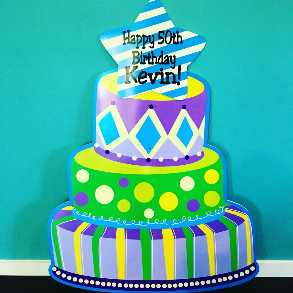 Purple and green cake sign