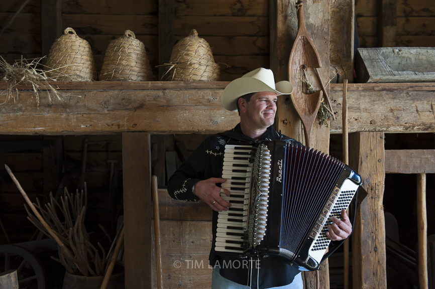 Jim Keyes plays his father's accordion in the barn at Philipsburg Manor on Sept. 3.