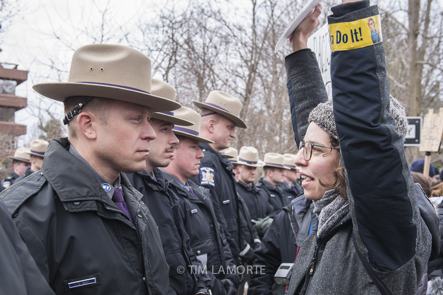 Anna Adler talks to a state trooper at Exit 9.