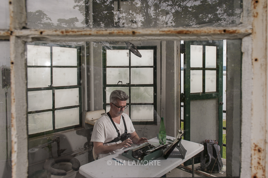Tim Youd sits inside the former guard tower on June 10. For audio, click below.
