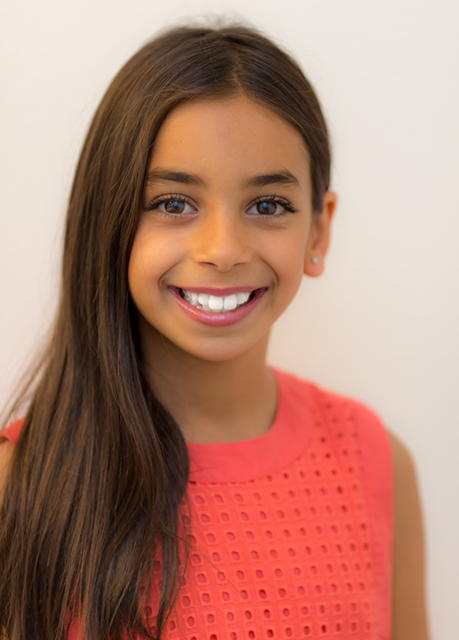 "My name is Alexandra Nicola. I'm 10 years old, in Fifth Grade. I'm originally from Australia, and have moved to the US with my family a year ago. The Happy Elf is my first ever performance (apart from school plays), and I am very excited to be playing ""Molly"". I am very passionate about singing, acting & gymnastics. I am very happy that my first experience in the theatre is with Stone House Theater Co. The cast members and staff are very friendly & supportive. To participate in The Happy Elf as a cast member is very special for me as I grew up watching it on DVD throughout the Christmas period ever since I was 4 years old. I hope you come along and enjoy this play with your kids."