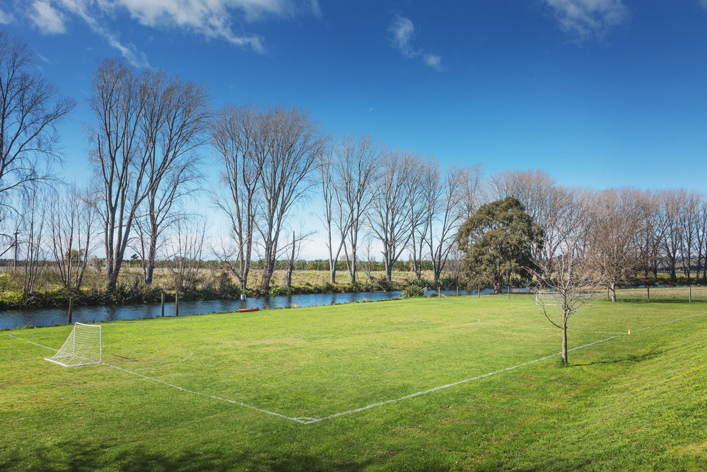 Recreational field alongside the Opawa River