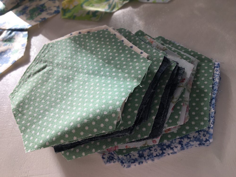When I cut out the hexes I sort them, one green centre six petals, good way to keep organized.