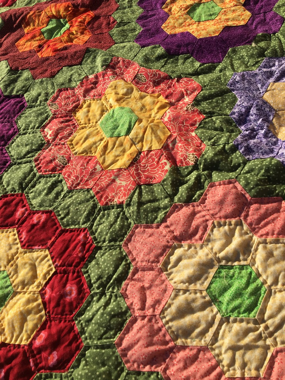 As much as I love the look of the hand stitching, I do not have the time to do so. I also don't love this quilt as much as I once did 7 years ago so it won't get the attention the I would need to give.