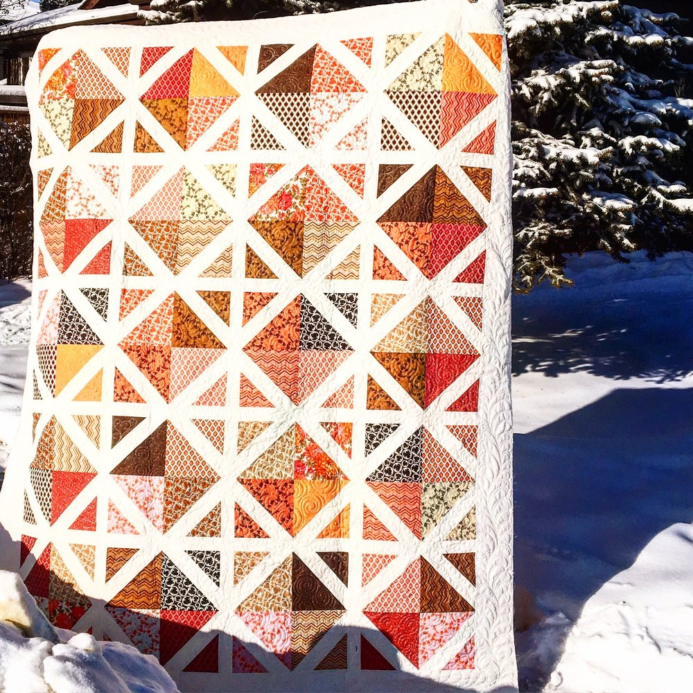 Love this client quilt that I did custom quilting on. www.stitchedquiltingco.com
