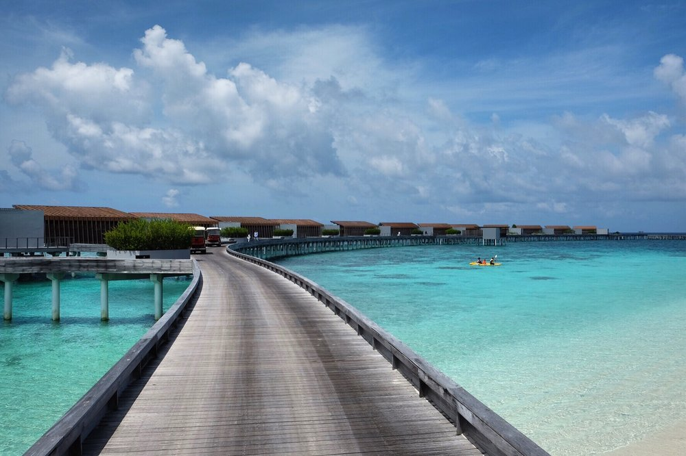 The Hadahaa's Park Water Villas line this curved jetty.
