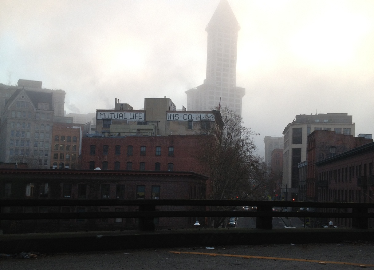 Pioneer Square and Downtown. Smith Tower in a distance in the freezing fog.