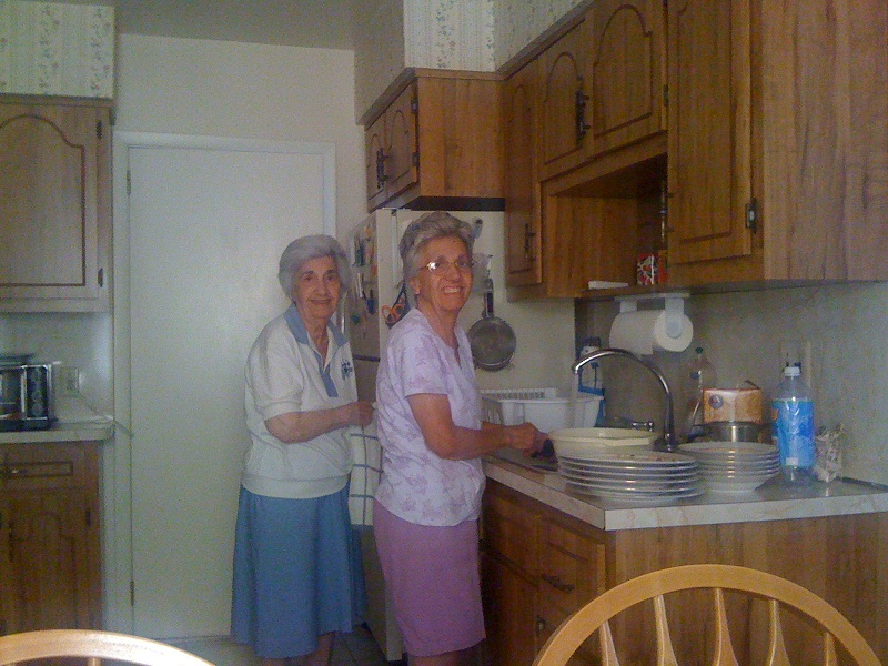 My Aunt Fran in her kitchen. Aunt Fran on the right with her older sister Anna.