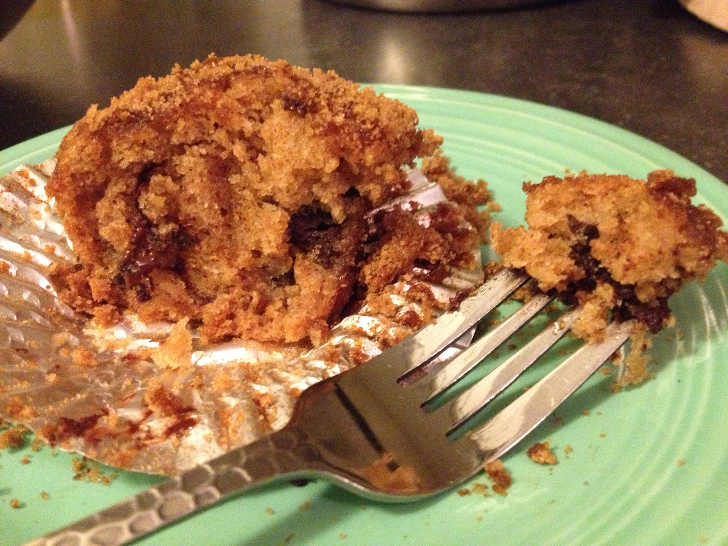 Warm Applesauce Spiced Chocolate Chunk Cupcake, partially devoured.