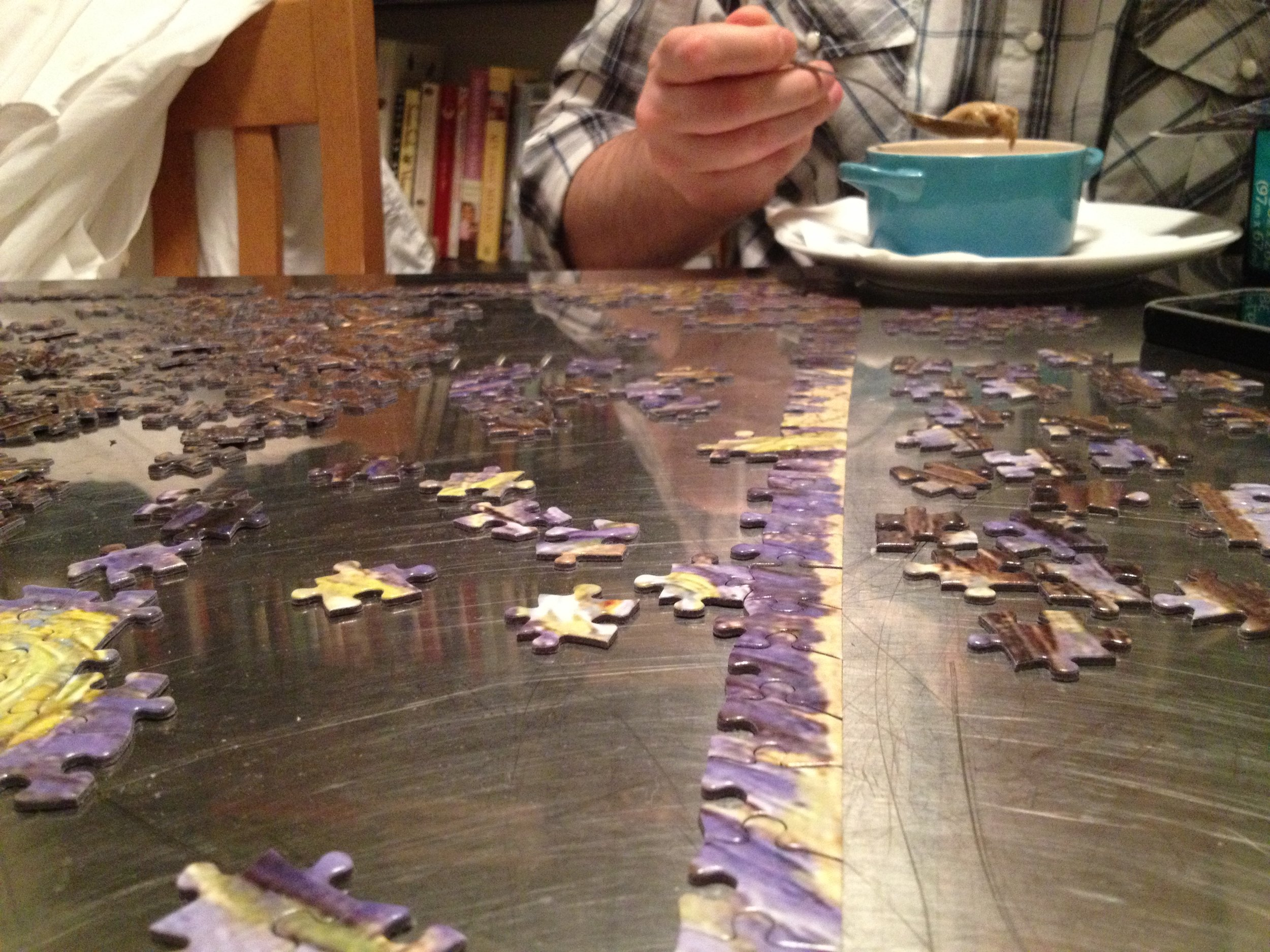 Brian eating his Coffee Creme Brulee while attempting this crazt puzzle.