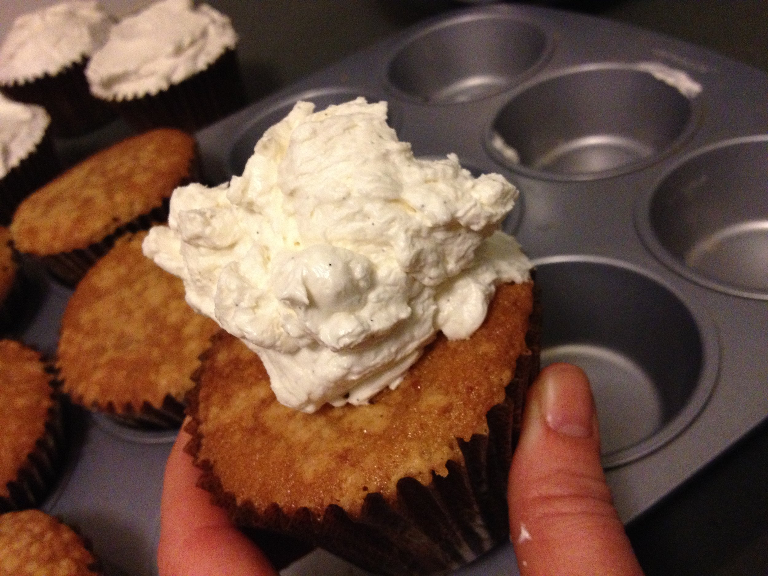 Silky Italian Buttercream flavored with Vanilla Beans is perfect for  these Almond Cupcakes.