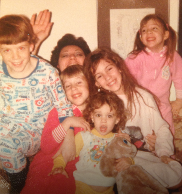 My Aunt Marie, my cousins, myself, and my little sister in front with the ET doll. This must be 1982 / 1983. As you can see we loved to play with my aunt growing up. (Picture compliments of my cousin who sent it to me a couple of months back.)