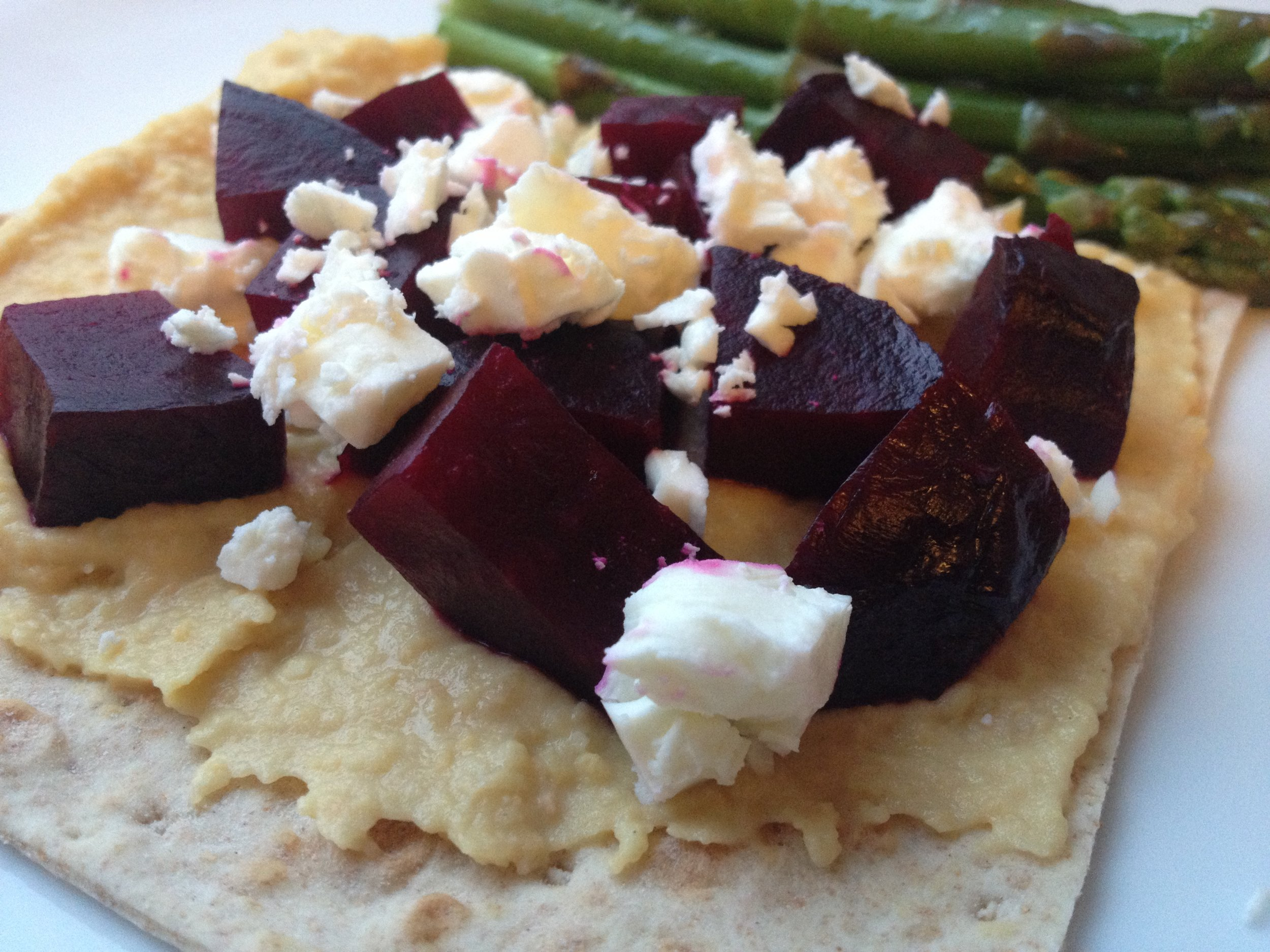 My most favorite way of eating hummus, with roasted beet and topped with feta.