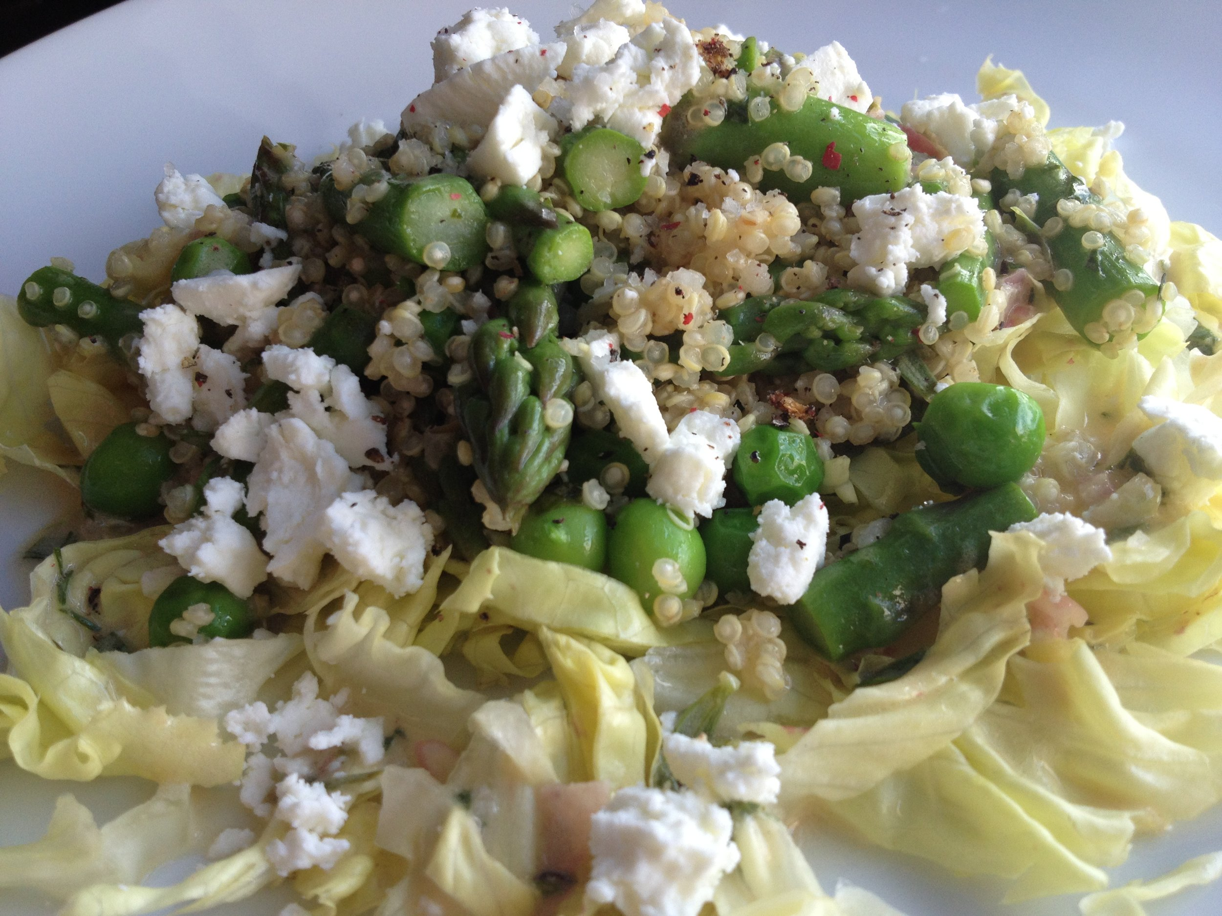 Hearty  vegetable salad, with asparagus, peas, and quinoa.