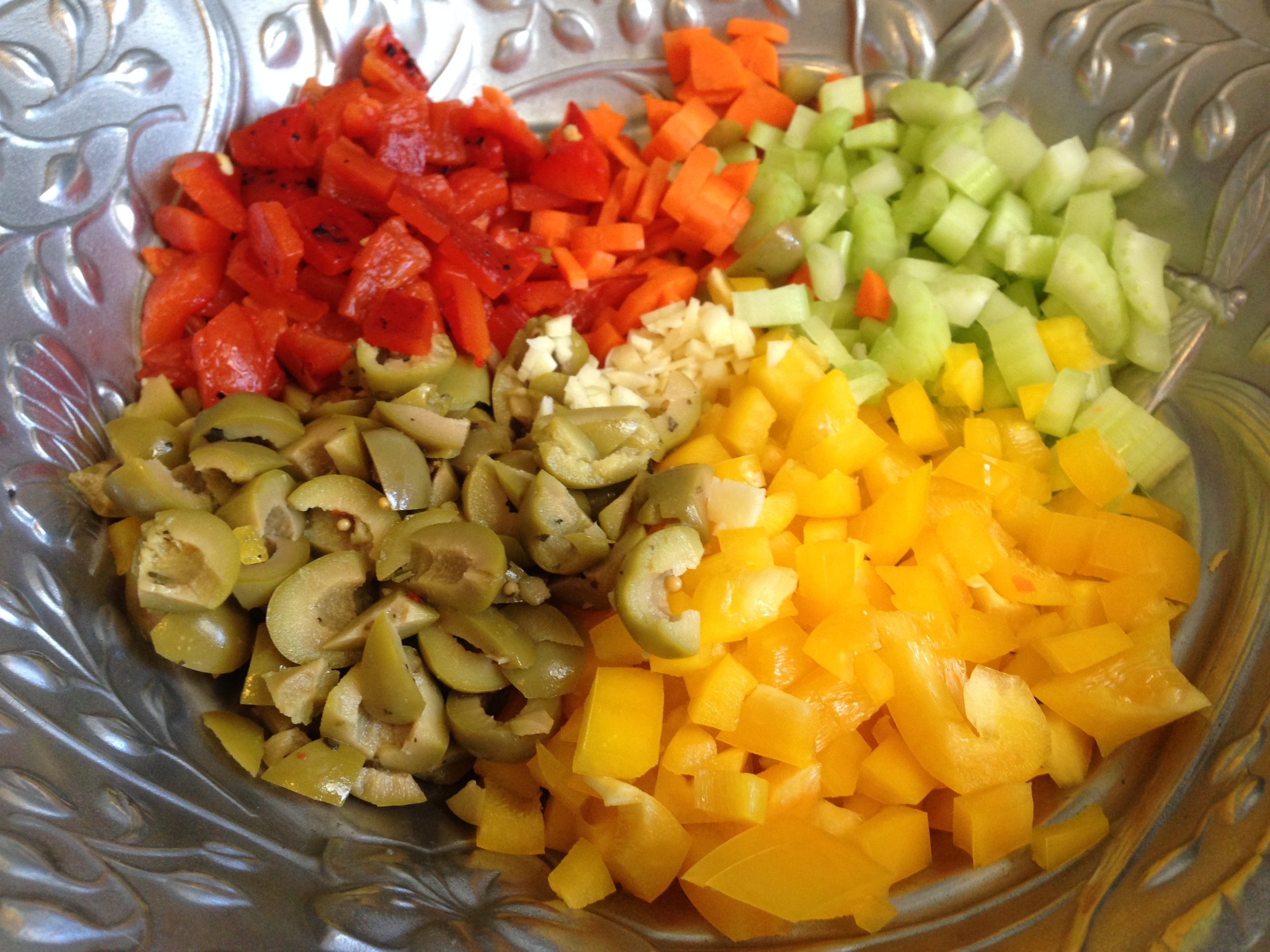 Veggies, olives, and garlic ready.