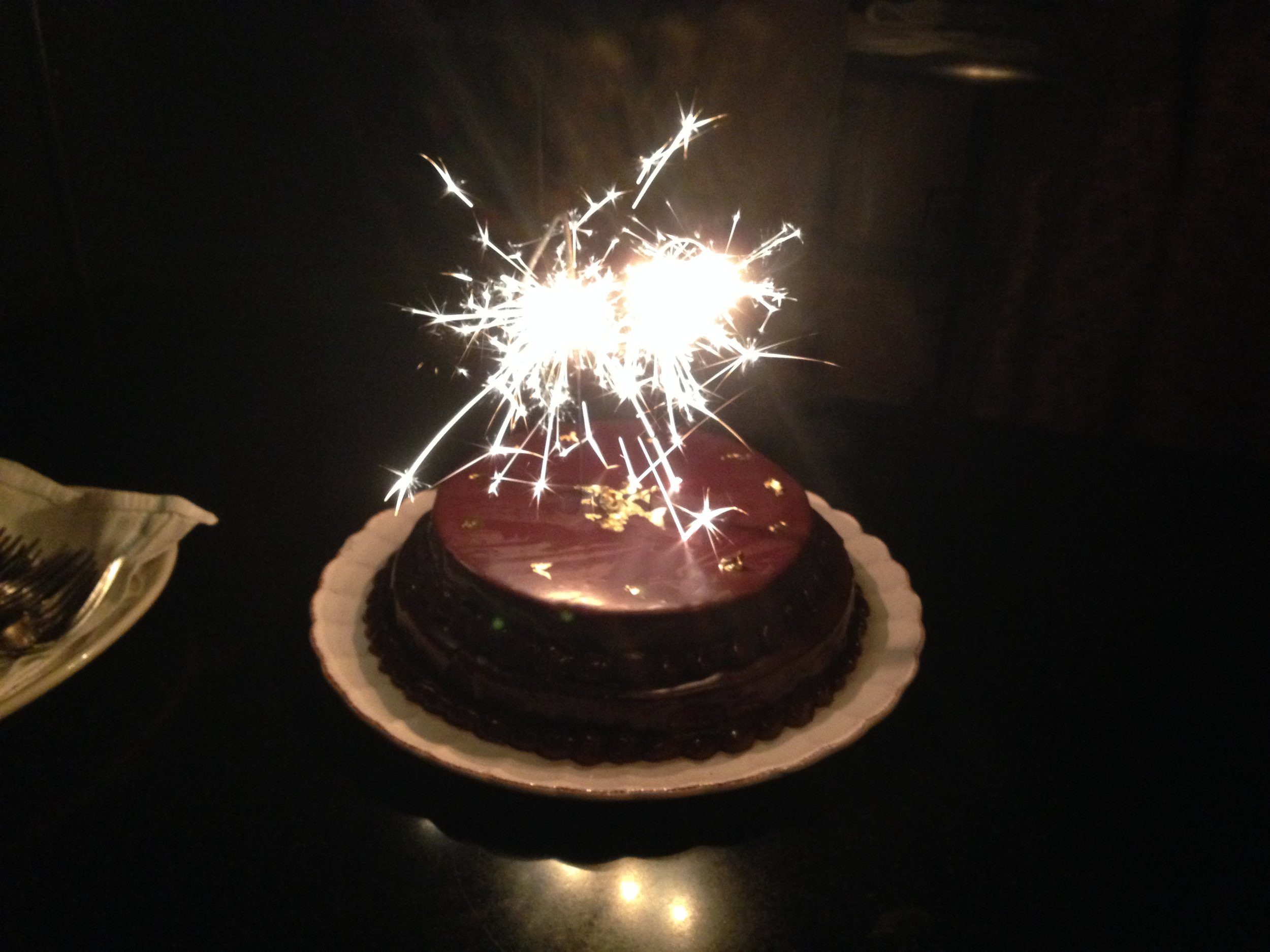 Sparklers ontop of cake to celebrate.