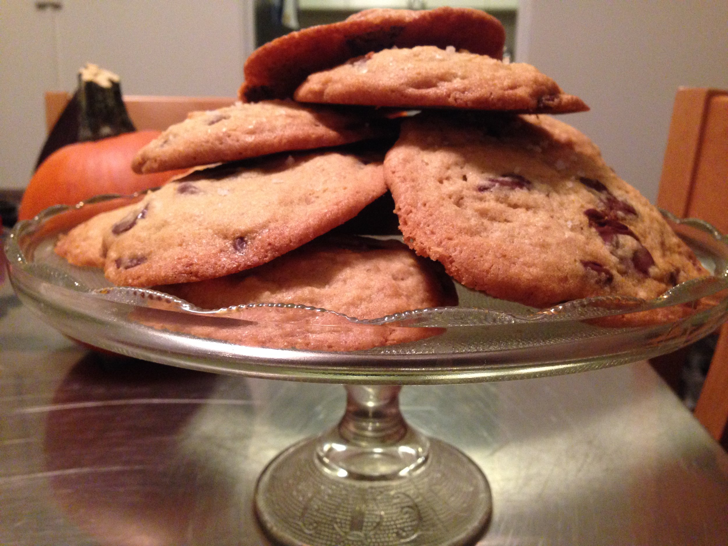 The best chocolate chip cookies stacked high after cooling.