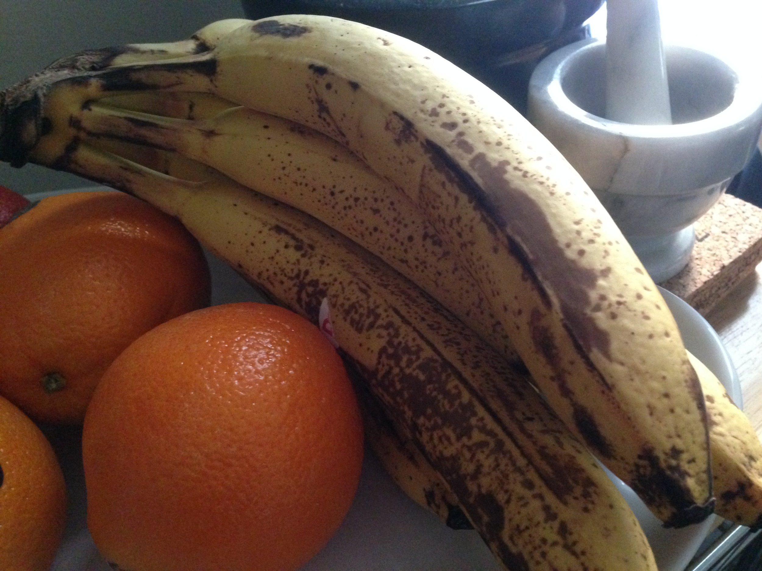 Some of the ripe bananas and the oranges I picked up from the market.