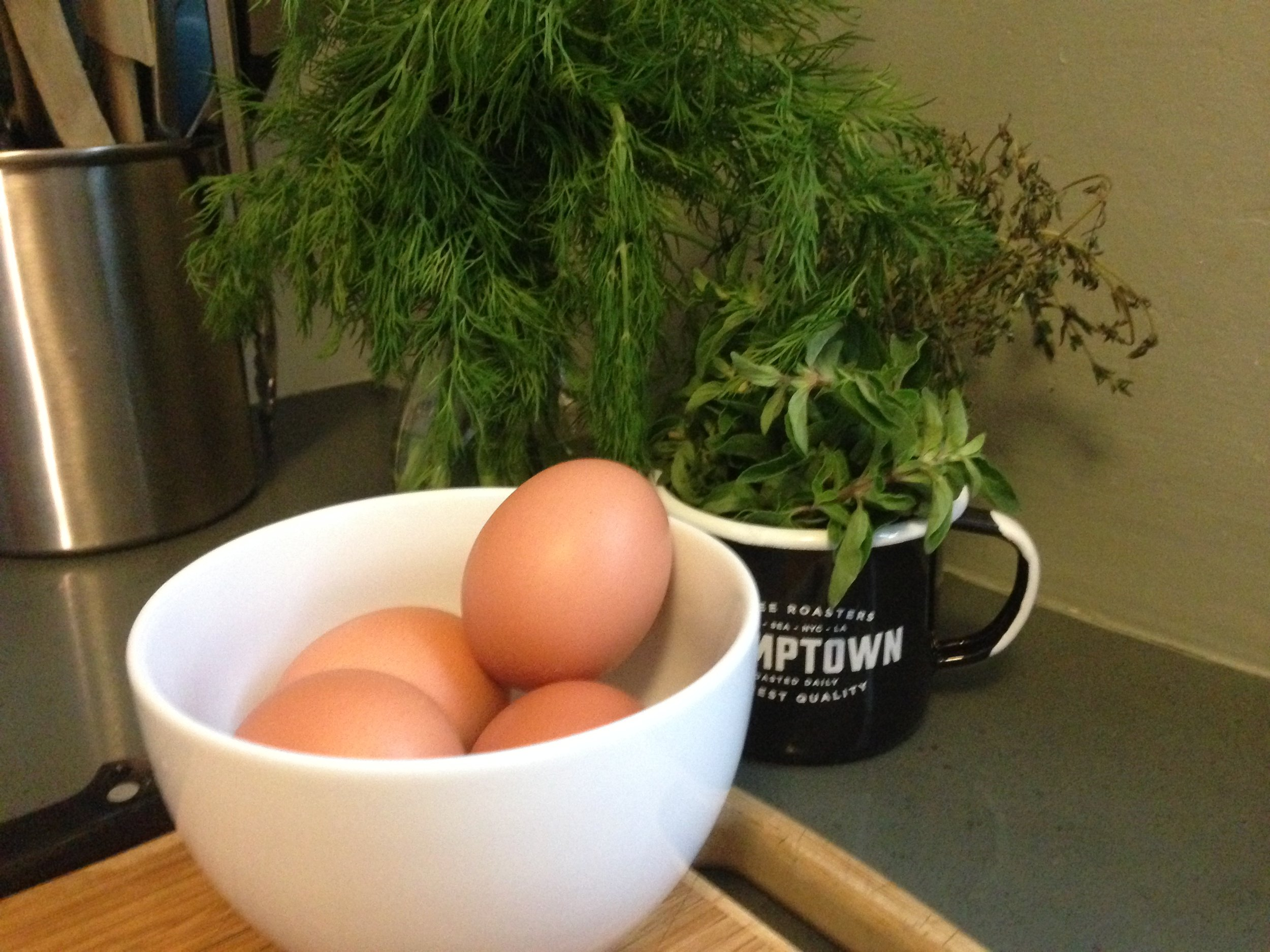 Eggs, and assorted Fresh Herbs for my Omelette.