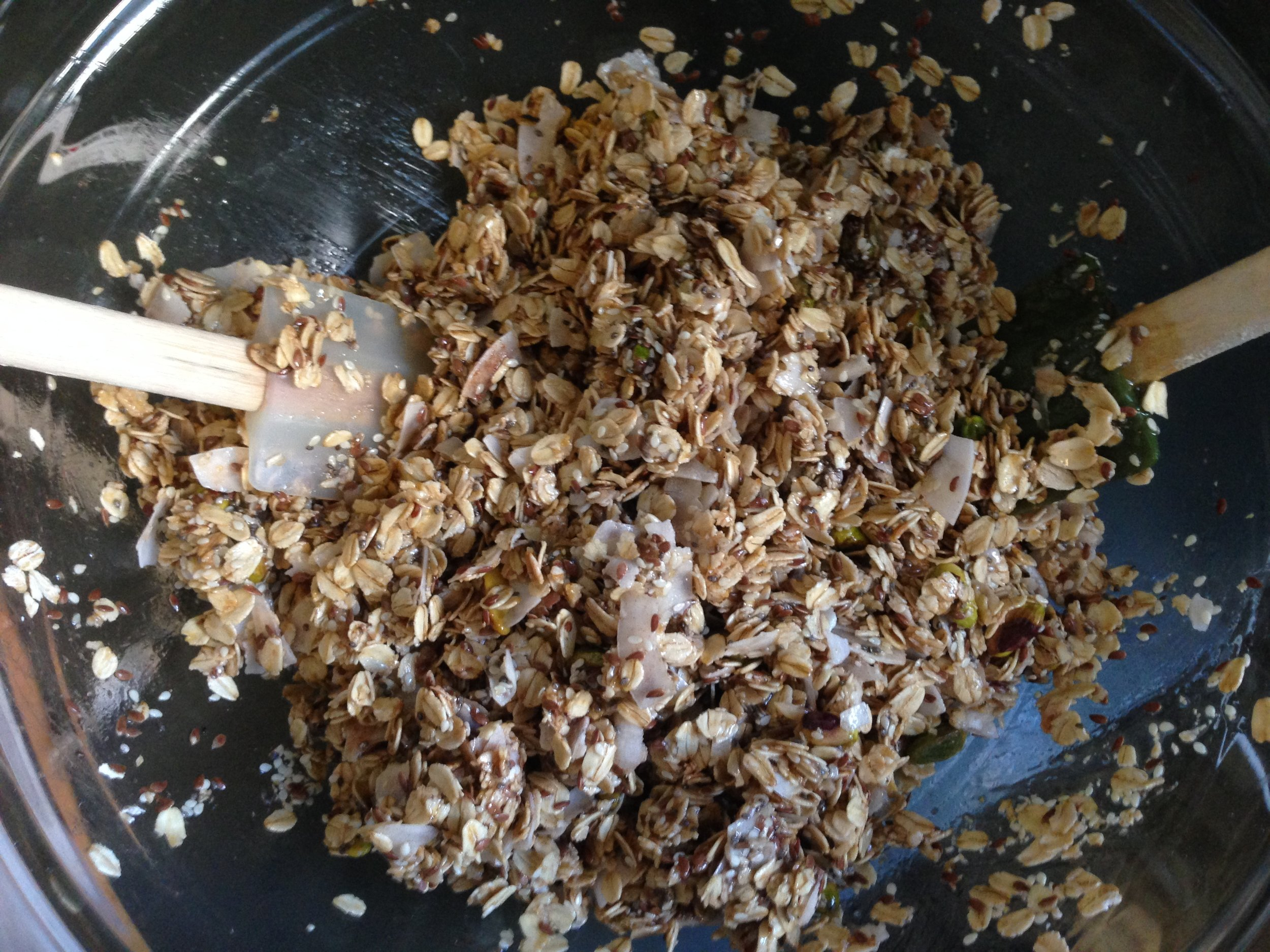 Tossing all the granola ingredients together.