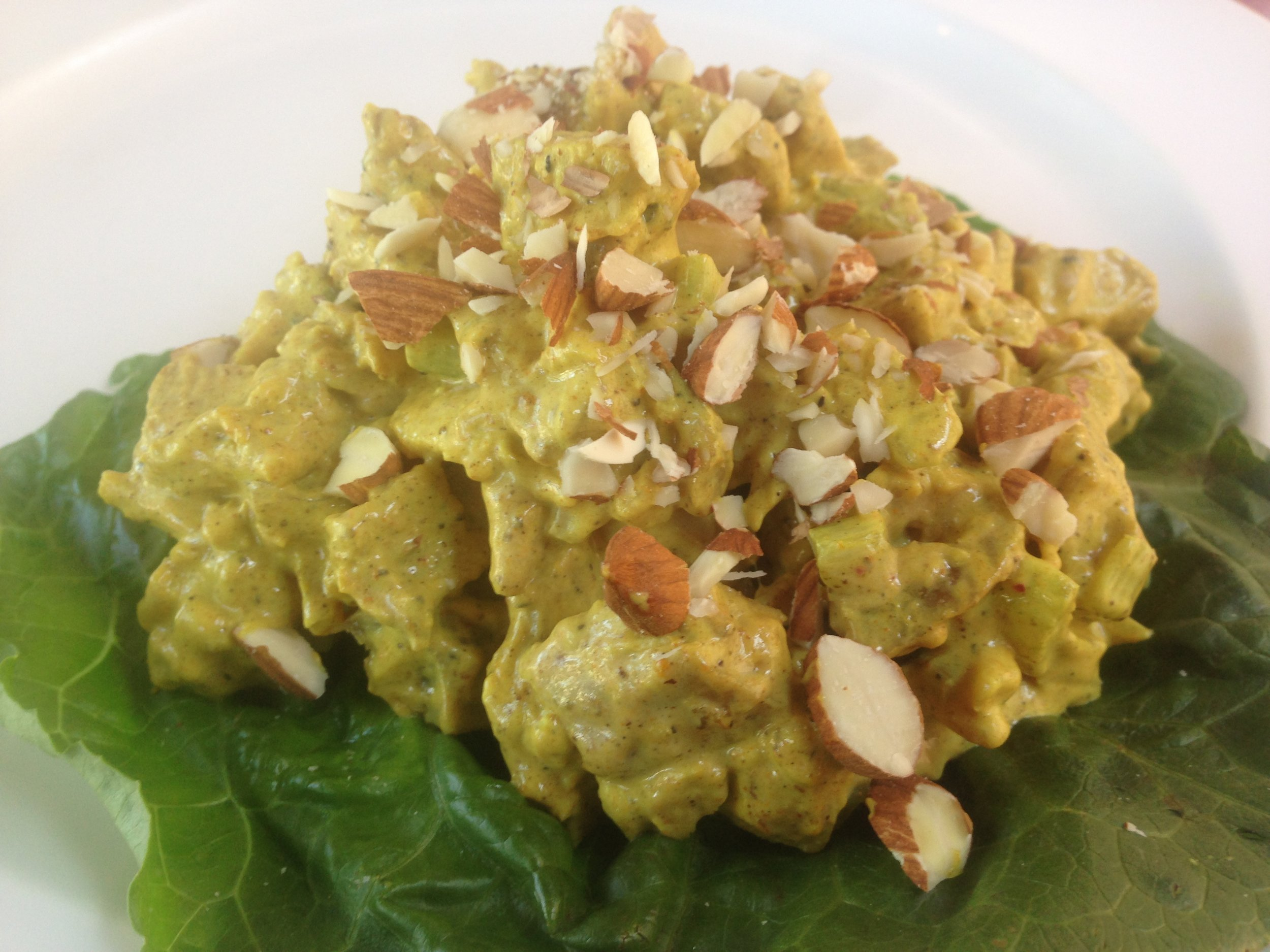 Curry Chicken Salad with almonds over the top. Served and ready to dig in.