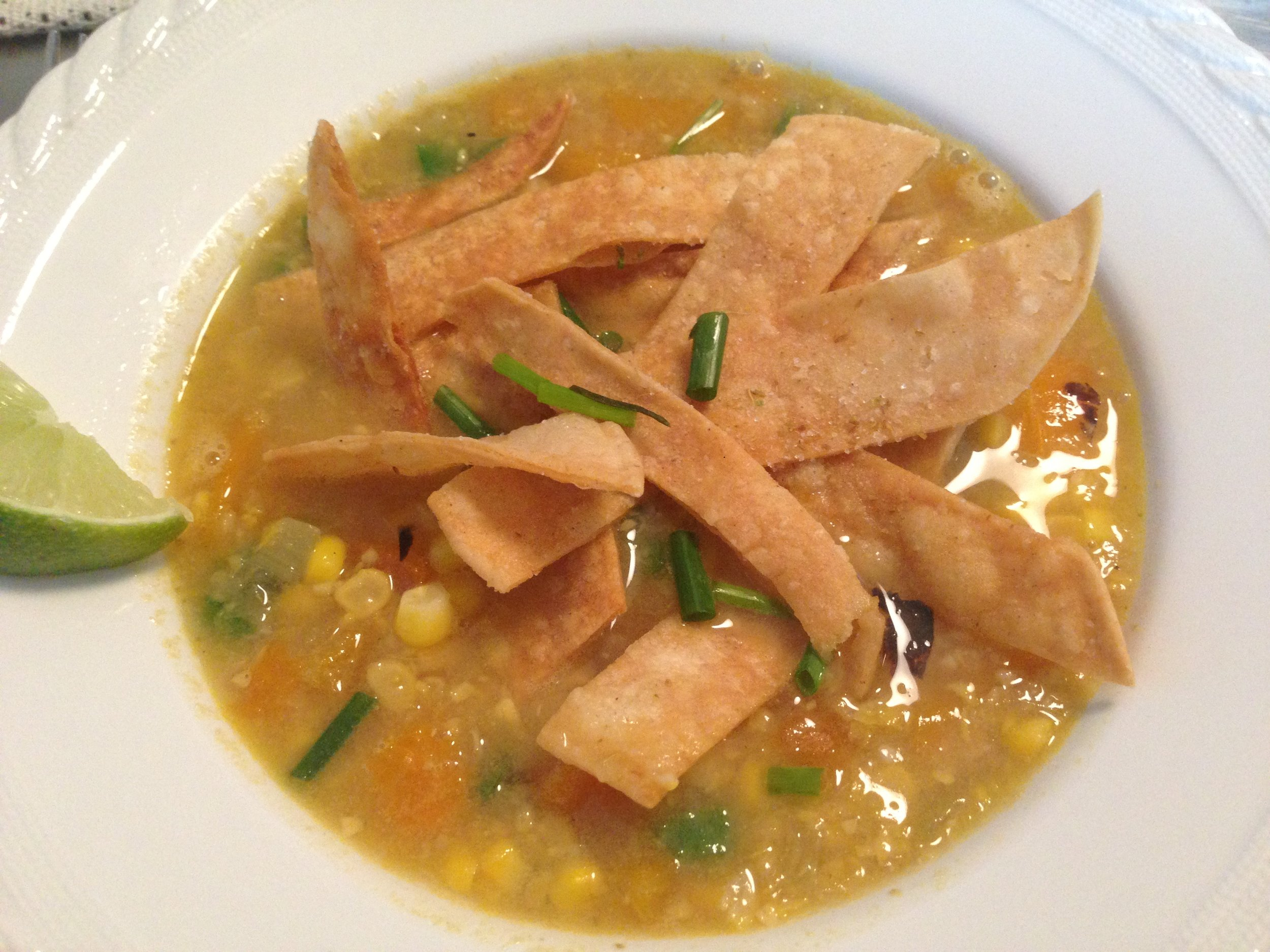 The Corn Lime Soup topped with the Cumin Lime Tortilla Strips.