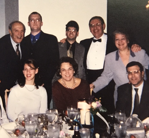 My cousin Frannie is front and center, myself to her right, and a few more of our family. (November, 1999)