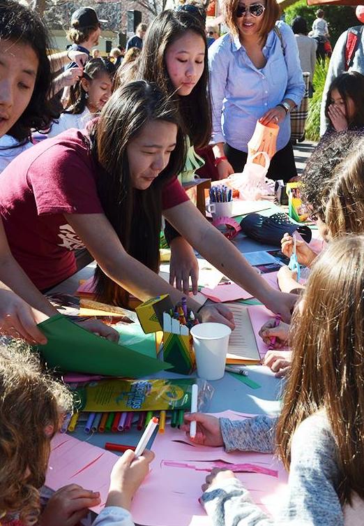 Volunteers from OneSky helped us make paper lanterns.