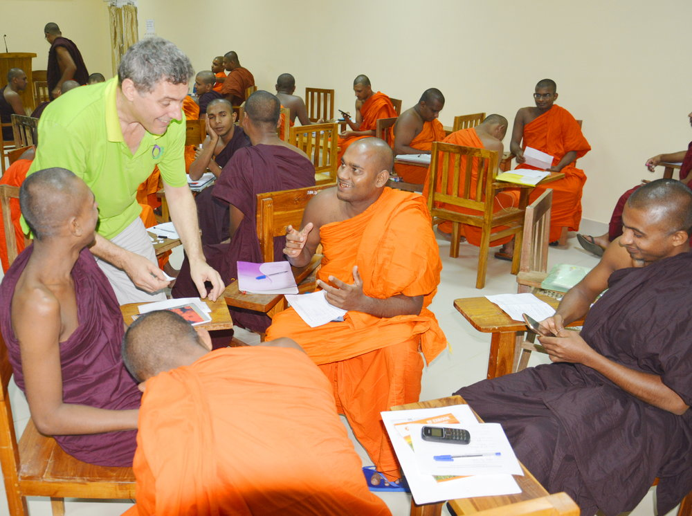 Explaining an English language learning game to monks of the Bhiksu University