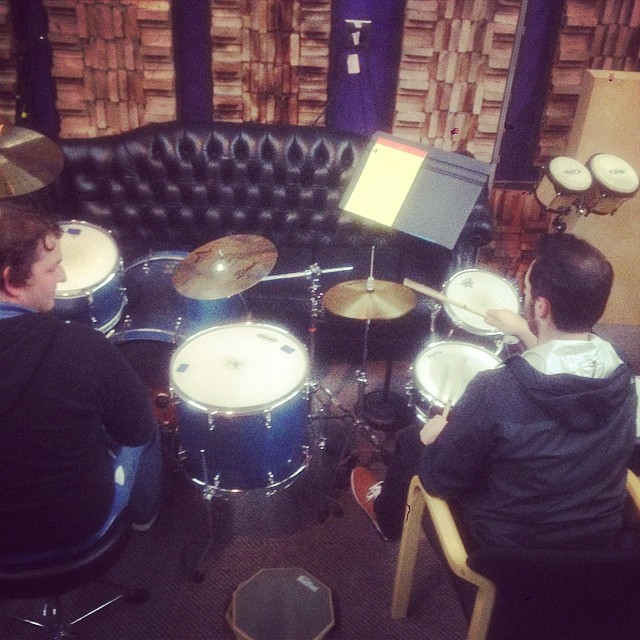 Working with our producer Bryan Lash on drums - yeah, Bryan knows how to make a tiny children's drum set sound kick ass!