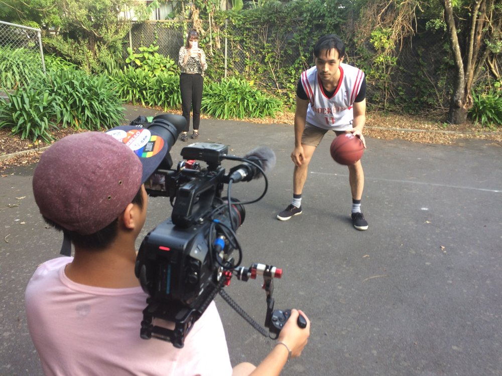 Calvin Sang shoots Yoson An shooting hoops.
