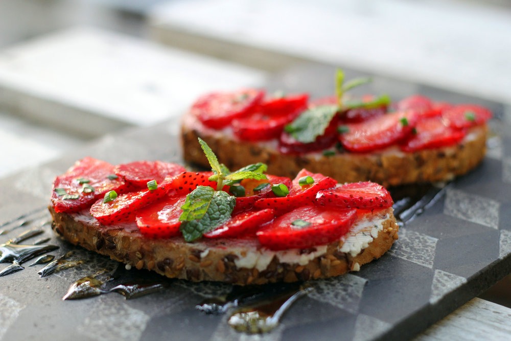 Goat Cheese Tartines: Goat cheese, onion chives, strawberry, honey served on sliced toast bread