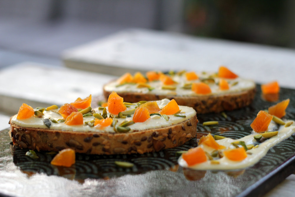 Labneh Twist Tartines: Dried apricot, orange zest, walnut, pistachio and labneh served on sliced toast bread