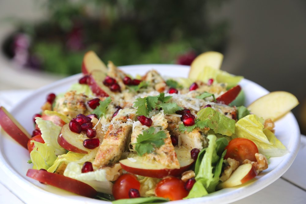 Chicken Apple Salad: Grilled chicken, mix leaves, cherry tomato, thinly sliced apples, pomegranate, walnuts and parmesan cheese