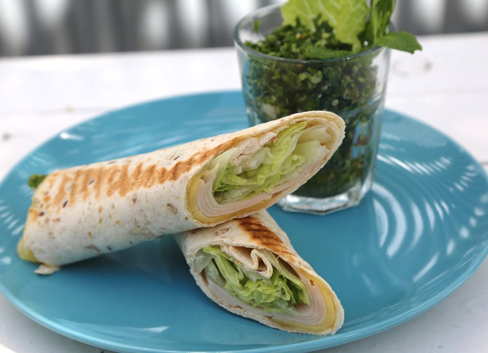 Turkey Wrap: Turkey and cheddar cheese served  with tabbouleh salad