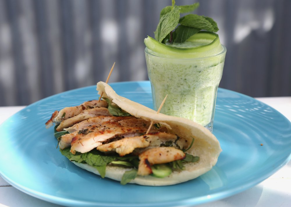 Oregano Chicken Wrap: Grilled chicken in flatbread,  rucola and thinly sliced cucumber with tzatziki