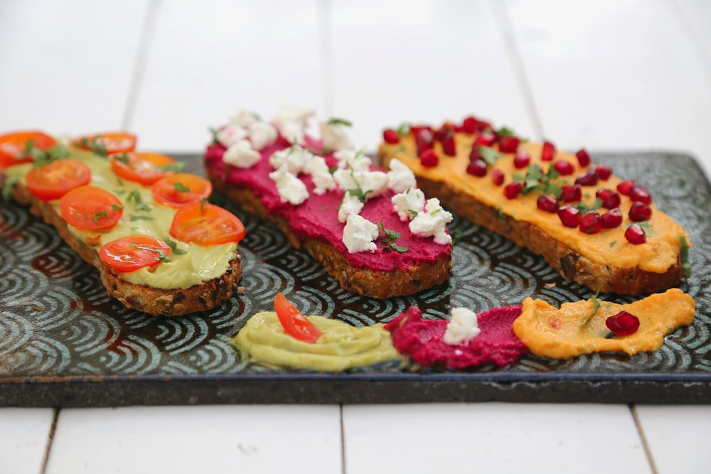Hummus Tartines: Beetroot, Avocado, Carrot hummus served on sliced toast bread