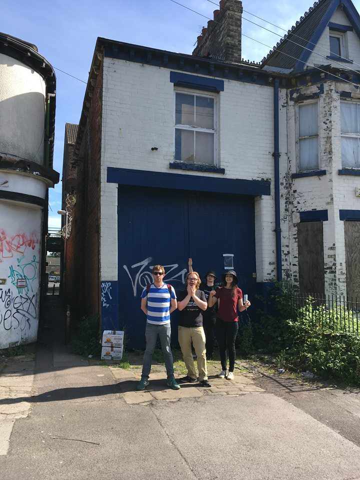 Adam's photo of Paul, Mary, Chris and Tom from DCW outside a haunted house in Hull that's mentioned in a Black Kes song.