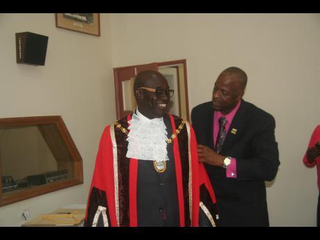 To left, Lucea mayor Sherridan Samuels.  Image credit: Jamaica Gleaner