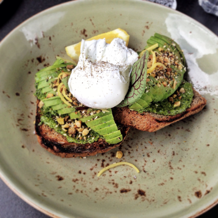 Not-so-humble smashed avo: GF Precinct Gluten-free toast, kale pesto, avocado, poached egg, pickled lemon, pistachio chia dukkah.
