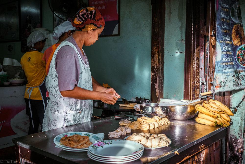 Ladies making banana roti at 7am