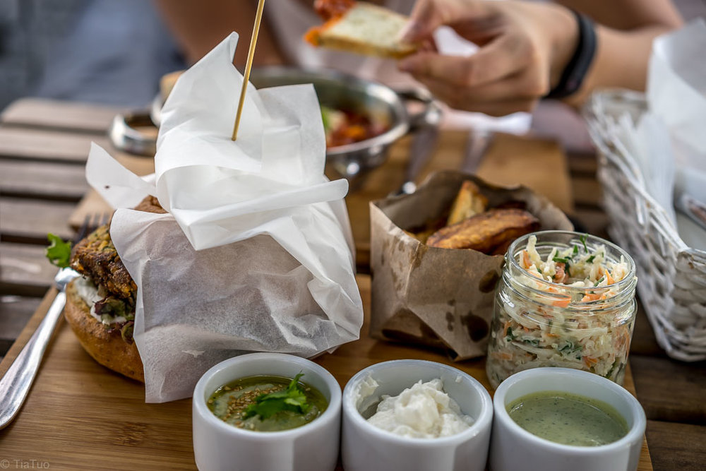 Burger, fries, coleslaw and 3 dips: aioli, tahini and a side of parsley hummus
