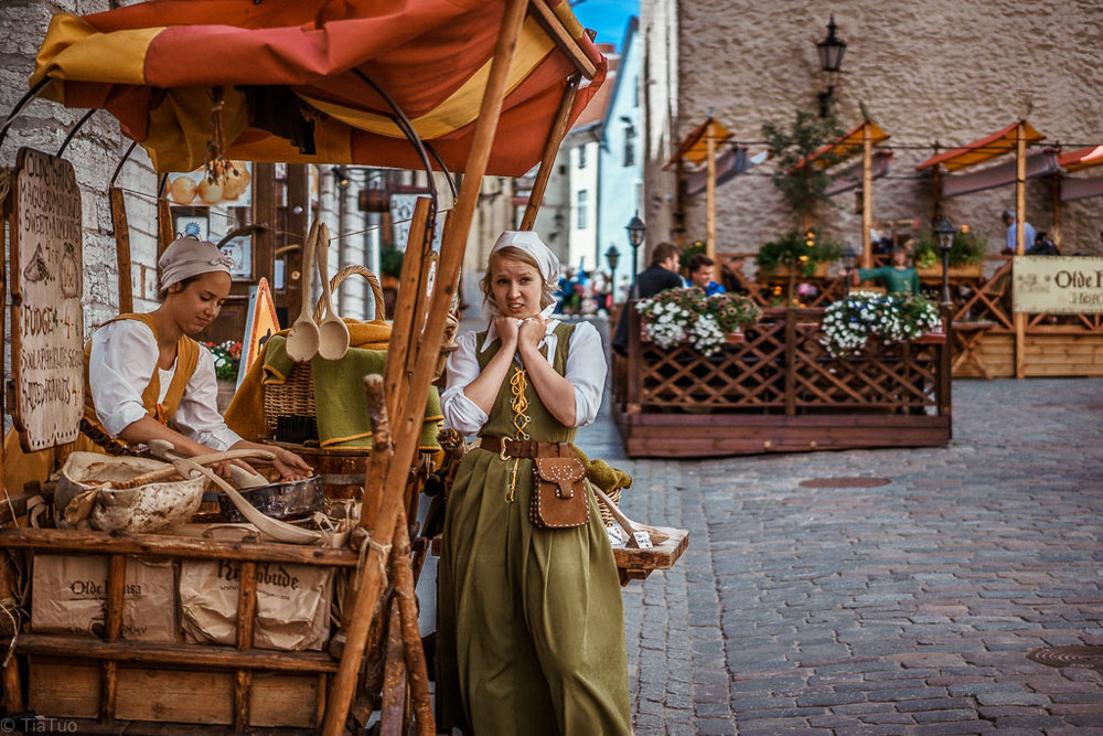 Medieval ladies selling almonds