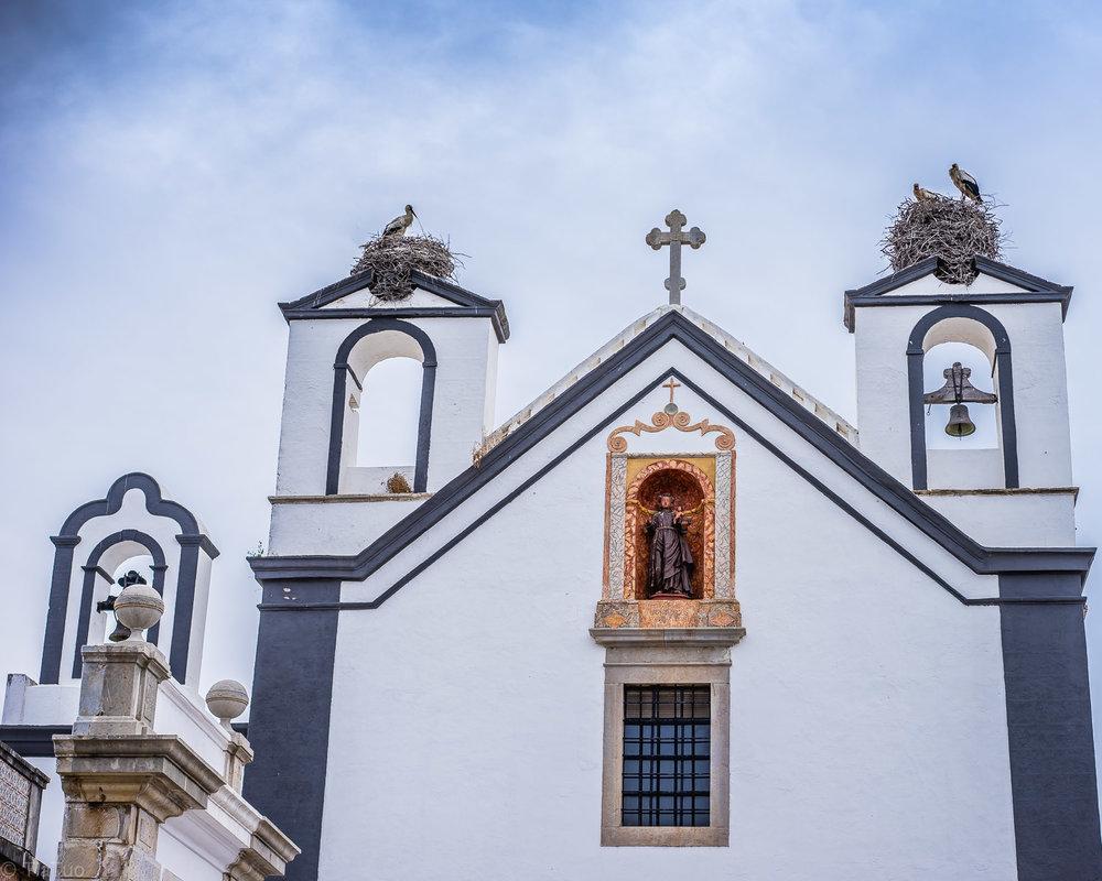 Cranes residing atop a church