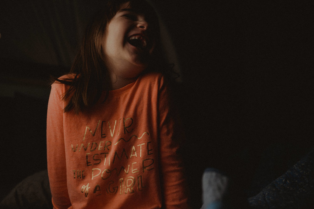 I've been playing around with minimal light. This was taken with just one, dim lightbulb as my only source of light.