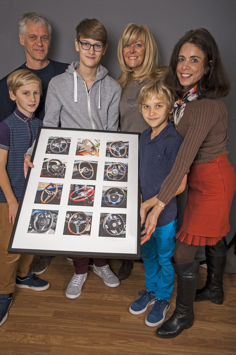 - The winners from Stella's exhibition;'A Drive Down Memory Lane' at 'Chartwell' - Westerham, Kent, UK in 2014.Much to their delight, Nigel Hasler, Julia Cambridge and Nigel's sons; Jake, Ben and Joe, wereawarded the 'Steering Wheel' framedlimited edition photograph.