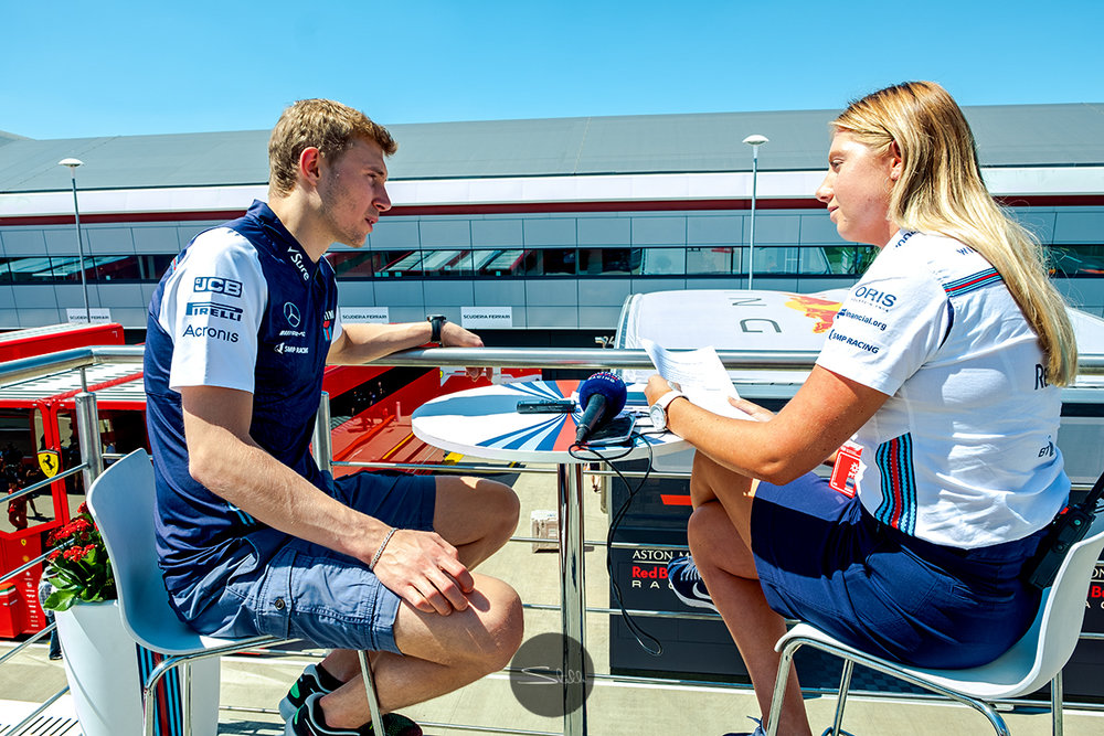Sergey speaks to Emma, a member of the Williams Communications team